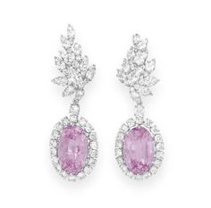 A PAIR OF KUNZITE AND DIAMOND EAR PENDANTS   Each set with a detachable oval-cut kunzite within a circular-cut diamond surround, from a circular-cut diamond link, to the diamond foliate cluster, mounted in platinum  Kunzite drops signed Verdura