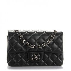 bba1ca870ecf This is an authentic CHANEL Lambskin Quilted Rectangular Mini Flap in Black.  The chic mini cross body classic is crafted of soft quilted lambskin  leather in ...