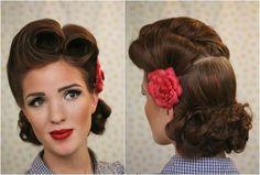 coiffure pin up glamour- chic rétro des 1940 avec fleur rouge