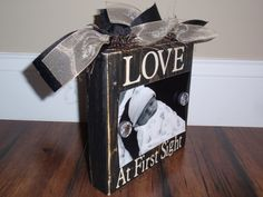 """Photo Block Picture / Clip in Black Weathered / Distressed Wood - Light Tan Vinyl Words """"Love At First Sight"""", Black & Tan Ribbon 4 x 6 Size. $18.00, via Etsy."""