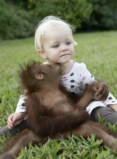 Kind of obvious I am awed at the cuteness of animals and kids together, especially baby ones. : )