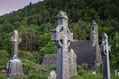 Finding Glendalough in the Wicklow Mountains of Ireland. Celtic crosses of Glendalough. There's just something about those Celtic crosses that kept drawing us back in. Explore the ancient side of Ireland in photos at http://www.divergenttravelers.com/glendalough-wicklow-mountains-ireland/