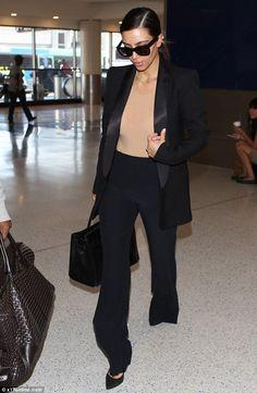 kim Kardashian at LAX  Stella McCartney pants, SaintLaurent pumps, Hermes Birkin bag So Black, Celine sunnies, Maison Martin Margiela bodysuit