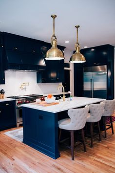 """Black Blue by Farrow & Ball. """"The homeowners wanted something classic but (which) still made a statement,"""" s . Luxury Kitchen Design, Best Kitchen Designs, Interior Design Kitchen, Navy Kitchen, Kitchen On A Budget, Kitchen Decor, Kitchen Island, Kitchen Cabinets, Black Cabinets"""