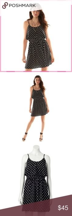 ELLE Tribal Dot Popover Dress NWT Elle black & white tribal dot popover dress will put your sweet sense of style on display. Popover styling features a flounced bodice that floats away from the body, giving you a feminine, flowing look.  FEATURES: *Scoopneck, Adjustable spaghetti straps, Lightweight crepe construction, Unlined  *30 3/8-in. approximate length *Popover styling, Elastic waistband *100% Polyester, Machine wash *S (4-6), M (8-10), L 12-14), XL (16-18)  *Bundle Discounts * No…
