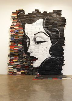 Mike Stilkey, Reminiscent, 2010. Acrylic on books. Installation at Hurley International, Costa Mesa, California.