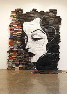 Mike Stilkey,Reminiscent, 2010. Acrylic on books. Installation at Hurley International, Costa Mesa, California.