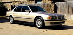 Restored 1998 BMW 740i  with new chrome front grilles and black-wrapped roof