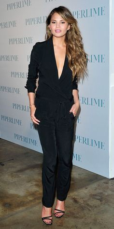 Chrissy Teigen accessorizes her long sleeve drapey romper with EF Collection earrings, bracelets, and a Melinda Maria ring. // #Celebrity