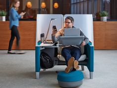 Brody Research, from Steelcase, is a one-person pod with an adjustable chair, a titling work surface, a footrest, and a privacy screen that encircles the person within.