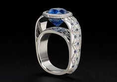 Zoltan David Couture Ring 6.69 ct. Sapphire, set in platinum and accented with diamonds and sapphires.