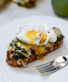 Broiled Fontina Toasts with Roasted Garlic (kale, mushrooms and Brussels sprouts) and Poached Eggs I howsweeteats.com