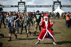 WACKEN, GERMANY - AUGUST 04: 27 year-old Mark from Randers, Denmark, stands dressed as Santa Claus during the Wacken Open Air festival on August 4, 2016 in Wacken, Germany. Wacken is a village in northern Germany with a population of 1,800 that has hosted the annual festival, which attracts heavy metal fans from around the world, since 1990. (Photo by Alexander Koerner/Getty Images)