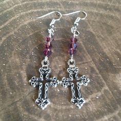 A personal favorite from my Etsy shop https://www.etsy.com/listing/526206071/cross-earrings-tibetan-silver-purple
