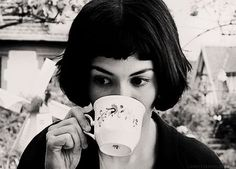 Amélie Poulain drinking coffee