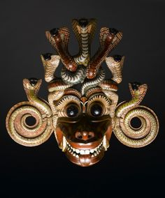 Mask of Naga Raksha, who represents the symptoms of poisonous snake bite, carved and painted wood: Sri Lanka, 19th century © National Museums Scotland