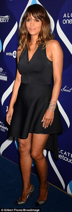 Raising temperatures and hemlines: The actress showcased her toned legs in the skimpy froc...