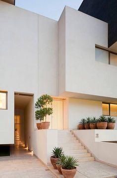 Black & White House by AGi Architects
