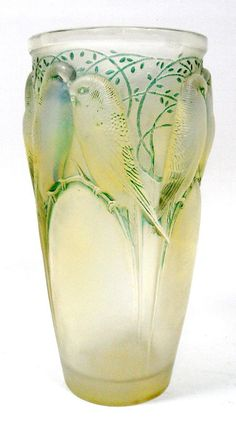 "R. Lalique ""Ceylon"" vase. The vase is crafted of opalescent glass with a sepia patina. Pairs of lovebirds are featured around the top of the vase. Marked R. Lalique France and 905 on the bottom."