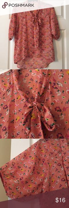 Sheer floral blouse with bowtie Floral sheet lateen. Collar with ties to make a joe or leave untied. Four buttons on cheat, also. Longer in back. Tag has been removed, will fit size small-med Tops