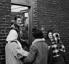 "Elvis signs autographs and chats with fans behind CBS Studios on March 17, 1956. He had just appeared for the 5th time on Jimmy Dorsey's ""Stage Show,"" produced by Jackie Gleason."