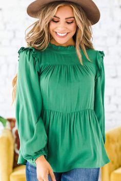 Add some class to your closet this season with our new Loma Ruffle Mock Neck Peplum! We love the sophisticated look of the mock neck, peplum cut, and the loose sleeves, and you will too! Our top features a gorgeous flattering texture and is so soft and easy to move around in, making it both comfortable and classy. Rock it with your favorite skirt or jeans for a perfect fall look! puffy sleeve tops, Fall Outfit Ideas, Fall Long Sleeve Tops