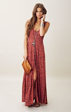 GOLD COAST MAXI DRESS he floral print and button closure lends a neo-grunge aspect to this Gold Coast maxi dress by Free People. Features a round neck, allover floral print and front button closure down center of dress that ends with a slit at front hem.