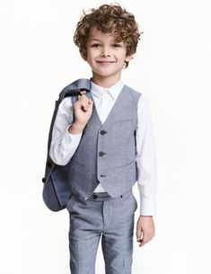 Check this out! Suit vest in oxford-weave cotton with a welt chest pocket, buttons, and mock front pockets. Attached decorative tabs at back. Lined. - Visit hm.com to see more.