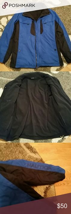 MEN'S reversible Nautica coat Blue and black windbreaker material with black fleece lining. Jacket is reversible with lots of pockets. Men's size XL. This is really two great jackets, in excellent used condition! Nautica Jackets & Coats