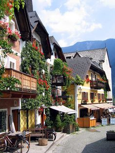 Hallstat town centre, Austria- I libe how the building hsve little balconies snd flowers all over.