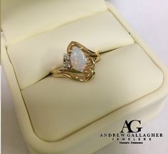 (7/01/15) 50% OFF! 14K Yellow Gold Teardrop Shaped Opal and Diamond Ring. The Opal is approximately 8mm x 6mm with two round cut diamonds set on one side of the opal. Original Retail Price: $495.00 SALE PRICE: $247.50. Item#: L0502M75 | | Call Andrew Gallagher Jewelers at 302-368-3380 for more information. We SHIP!! | #50OffJewelryCase