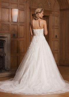 Brazil by Opulence, a beautiful lace gown with a fitted bodice and dropped waist. Available from Caroline Clark Bridal Boutique, Droitwich, 01905799474