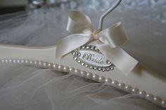 "New for 2015!!! Wedding Dress Hanger ""Claudette"" Bridal Hanger with genuine Swarovski half-pearls For more pics visit www.blackbowbridalhangers.com  #weddingdresshangers #weddingdresses #wedding #weddingdress #weddinghanger #bridalgownhanger #bridal #hangers #weddinggownhanger #gown hanger"