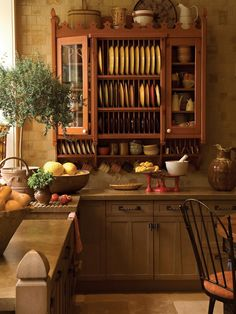 FAVORITE kitchen style: Italian charm. Love the wall tile and dish rack painted in paprika color. Cabinet hardward perfect. Looks like cement coutertops?