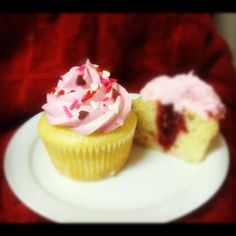 Vanilla Raspberry cupcake-vanilla cake filled with raspberry preserves, topped with fresh raspberry buttercream. Made by my sister, Meg Barrett <3