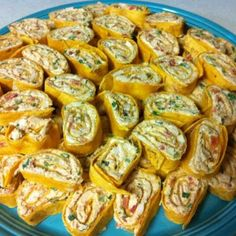 Chicken Enchilada Dip Roll-Ups- 2- 8 oz. pkgs cream cheese, softened,  1⅓ C shredded Mexican cheese,  1 tsp garlic, minced, 1½ Tbs chili powder, 1 tsp cumin, Cayenne pepper & Salt to taste, 1 Rotisserie (southwest) chicken, skinned & shredded, ½ bunch cilantro, chopped, 1 green onions, chopped, 10 oz. can Rotel tomatoes, 1 pkg jalapeno cheddar tortillas - Mix cheeses together until well blended. Add remaining ingredients  & mix well. Cover & refrig for 1 hr. Spread onto tortilla, Chill…