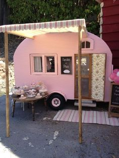 Miniature camper by Kim Saulter Tiny home house on wheels, pink travel trailer, glam glamour camping glamping, homemade awining, perfect little guest house.
