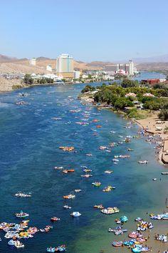 More than 20,000 people float down the Colorado River during the Bullhead City River Regatta in Laughlin, NV. Saturday, August 10, 2013. (Brian Jones/Las Vegas News Bureau)