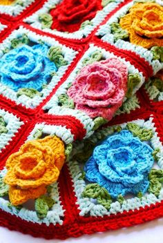 Crochet: Babouska Rose Blanket. I love this with the red between the squares.