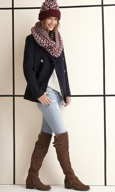 A lush suede, over-the-knee boot with buckles, straps and a stacked heel. Includes winter-friendly treading on sole.