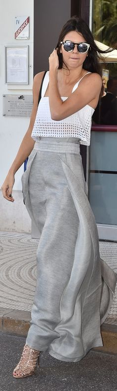 Kendall Jenner's daytime look was just as lovely as her red carpet ensemble. She paired a white eyelet crop top with a tailored heather gray skirt, strappy metallic pumps, and printed sunglasses.