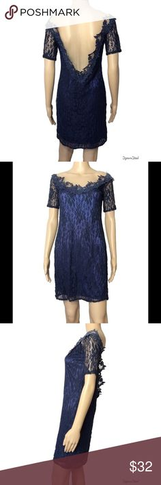 illusion open back dress NWOT royal navy blue dress.  No size tag on interior - would best fit those that are S-M (Mannequin's measurements provided below for size comparison)  No signs of wear in any sense.  Never worn.  Stretchy silk attached slip. Both the neckline and scooped back are an illusion mesh in a light nude color. The lace around the neckline/back is blue but has different hues of blue throughout the lace. Mannequin measurements: height - 5'8 Bust - 32 waist - 24.5 hips - 32…