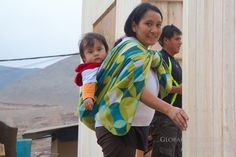 Building Homes in Las Laderas Peru - The owners of the new home. Her excitement was contagious!
