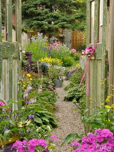 Thunder Bay, Ontario, is the home of many scenic views, including a charming country-style garden crafted by hardworking Sue Sikorski. Though it looks and lives large, this lush landscape is on an average-size city lot. Take a tour and learn about her mon Garden Crafts, Garden Art, Side Garden, Narrow Garden, Garden Planters, Herb Garden, Beautiful Gardens, Beautiful Flowers, Beautiful Space