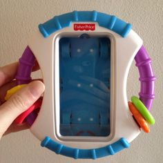 So smart! Fisher Price iPhone cover for babies. Turns your iPhone into a kid friendly device, blocks the home buttons so kids can watch or play a game without getting into anything on your phone.