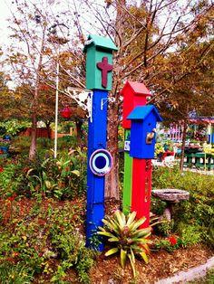 Colorful bird houses for the garden.