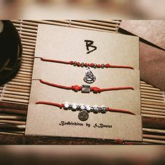 Set of 3 red string bracelets with charms Buddha and lotus by Tibetan silver. by BodhichittaBySB on Etsy