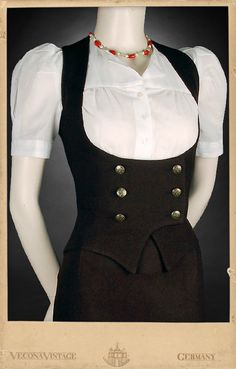 Did you ever wonder how it feels being hugged by sweet dark chocolate? Please have a try! Having a double breasted three button closure at the front this waist nipped vest conjures a silhouette that would have made Lena Horne pale of...
