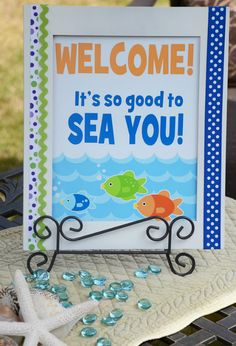 RAINBOW FISH PARTY: Cute welcome sign for Brynnlee's bday! In girl colors of course.