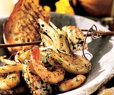 Seafood Kabobs!  These fish and shrimp kabobs include wedges of fennel. The fish, shrimp, and fennel are placed in a marinade that contains fennel, garlic, lemon, and oregano for an authentic Mediterranean flavor. After marinating, these seafood kabobs are grilled to create a delicious entree.
